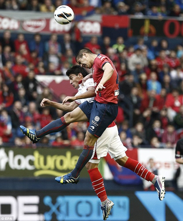 """Airborne: Standing at just 5' 7"""", aerial strength is not Navas's greatest asset. He is seen losing an aerial duel with Osasuna's 'Gato' here"""