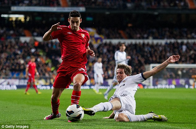 Speedster: The main asset of Jesus Navas, who signed for Manchester City from Sevilla this week, is his blistering pace. He's seen here skinning Real Madrid defender Fabio Coentrao in a La Liga match last season