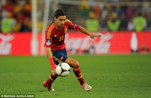 Foreign fields: Navas had to overcome his chronic homesickness before he could embark on an international career that has seen him win the World Cup and European Championships with Spain
