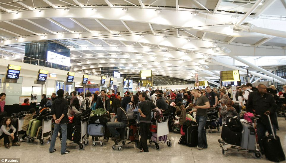 Chaos: People queue at check-in desks in the new Terminal 5 building in March 2008 after its new baggage handling system was suspended and dozens of flights were cancelled