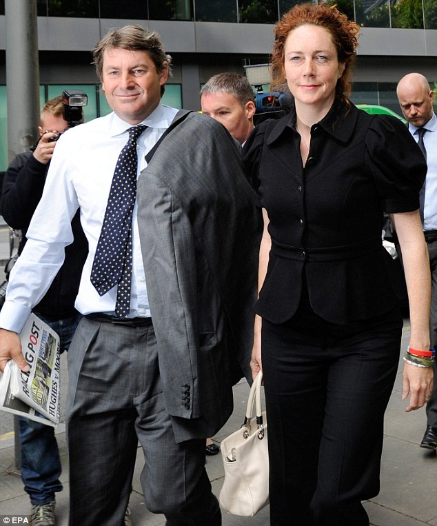 Hearing: Rebekah Brooks, right, and her husband Charlie arrive at Southwark Crown Court where they both denied all the offences they are charged with