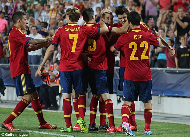 Celebrations: The Spain goal came just eight minutes from the end