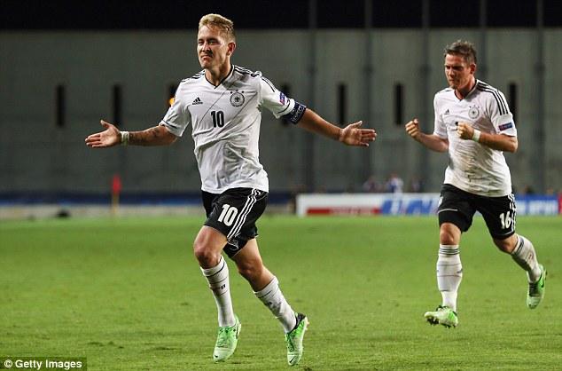Equaliser: Spurs' Lewis Holtby, the German captain, celebrates his goal