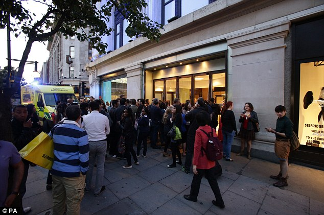 Onlookers: A crowd at the scene of a smash and grab robbery in Selfridges on Oxford Street in central London