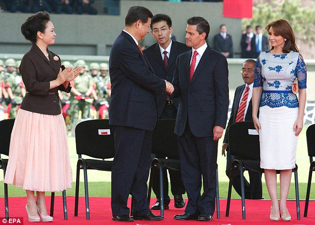 Fashionable: The visit puts Peng Liyuan, seen here with the Mexican first couple on Monday, on the world's stage