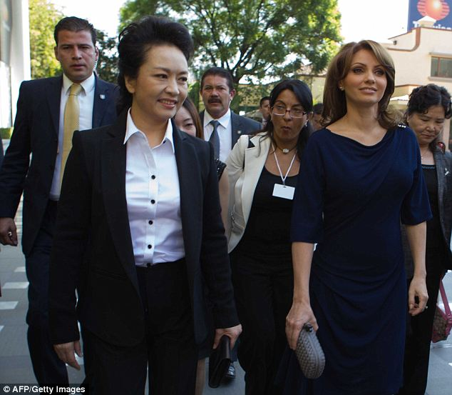 First Lady diplomacy: Many Chinese experts say Mrs Obama's move will be seen as a slight since other First Ladys- like Angelica Rivera of Mexico (seen on Tuesday at right)- made a point to meet with Peng Liyuan