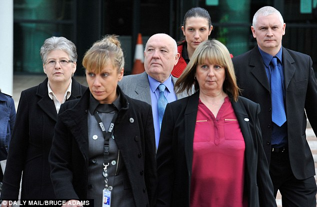 Family: PC Nicola Hughes's parents Sue (in pink ) and Paul (blue shirt and tie) and PC Fiona Bone's mother June (far left) arrive at Preston Crown Court for the trial
