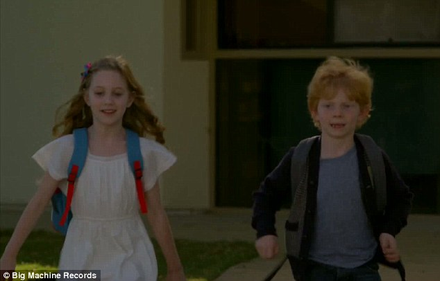 Mini-mes: Taylor Swift and Ed Sheeran have enlisted two lookalike children to star in their newly released music video for single Everything Has Changed