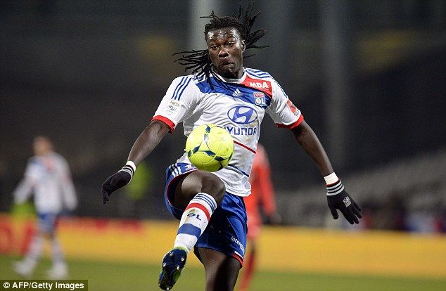 Firepower: Gomis has 42 goals in 90 starts for Lyon