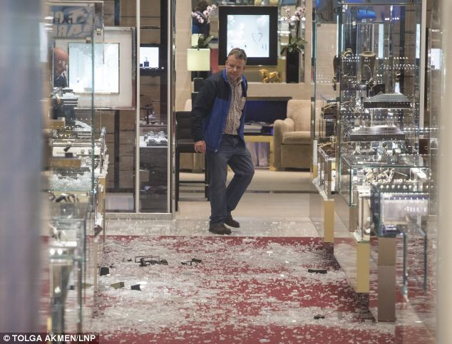 Destruction: A man looks at the damage left after an armed robbery at Selfridges on Oxford Street, London