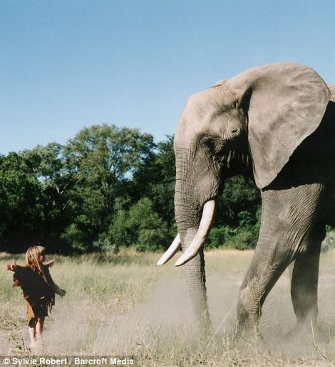 Tippi, aged 6 dancing with Abu the 34-year-old  elephant in Okavango Swamps, Botswana