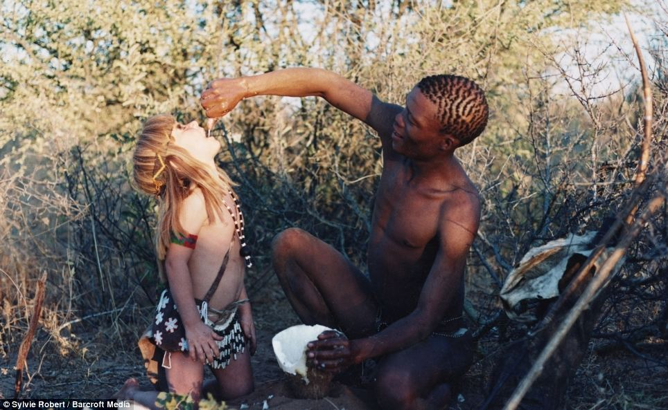 Thirsty work: Tkui of the San Bushmen of northern Namibia, feeds Tippi water from a root plant in Okavango Swamps