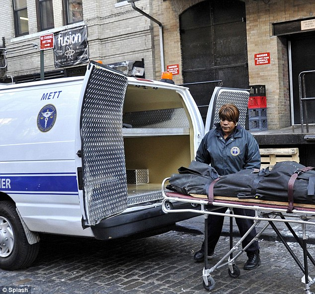 Gruesome: Cachay's body being removed from Soho House. She was found strangled with bite marks in a bathtub by staff after complaints of water leaks December 9, 2010
