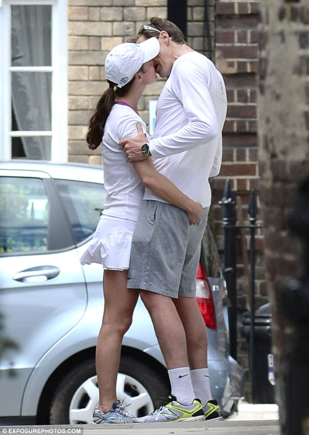 In for the kill: The pair share an amorous moment in a London street