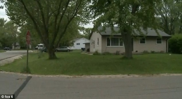 Pit bull attack: It was at this home in Caledonia, Wisconsin that a toddler was attacked by his family's pet pit bull - eventually having to undergo surgery for severe facial tears