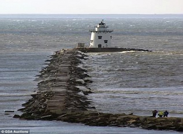 Bargain: Possibly the biggest bargain of the lot is the Saybrook Breakwater Lighthouse, pictured, which is up for sale for just $1
