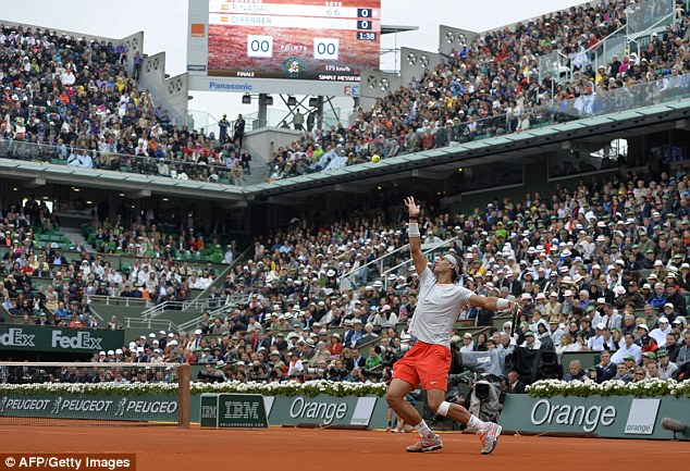 No stopping him: Nadal serves to Ferrer en route to his eighth title at Roland Garros