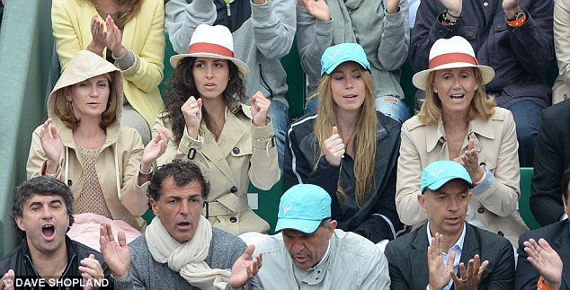 Support: Nadal's girlfriend Maria Perello (second left) celebrates his victory in the stands