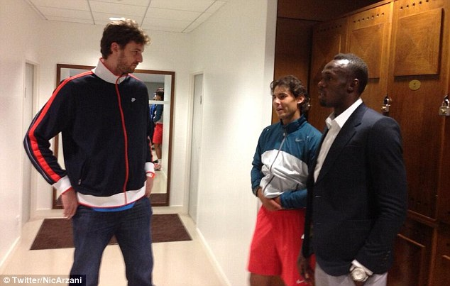 Towering above the rest: Spanish basketball player Pau Gasol joins Nadal and Bolt in the locker room after the match