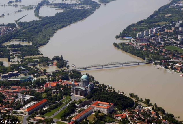 An aerial view of the swollen Danube River in Esztergom, 43 miles west of Budapest showed what the capital had in store on Sunday