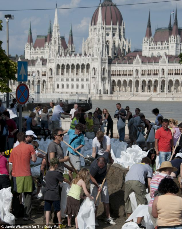 In front of Hungary's parliament buildings. volunteers joined together to protect Budapest using sand bags