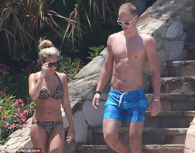 Ready for the beach: Manchester City goalkeeper Joe Hart and girlfriend Kimberly Crew head to their sunbeds
