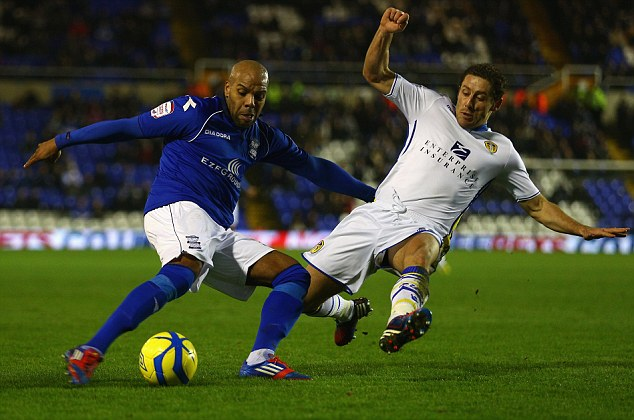 Studs in: Leeds midfielder Mihael Brown (R) has bemoaned the FA's 'farcical' coaching system