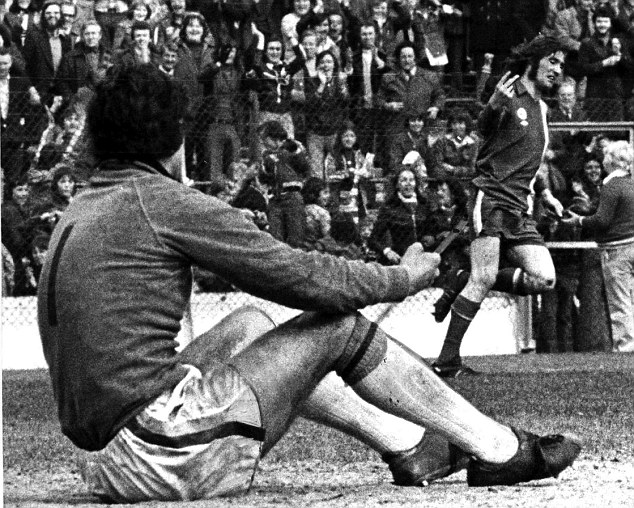 Loose cannon: Robin Friday sticks up two fingers at Luton goalkeeper Milija Aleksic after scoring in April 1977