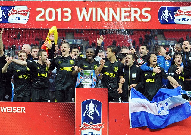 Party time: Wigan beat Manchester City to win the FA Cup but were then relegated from the Premier League