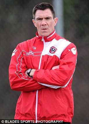 Falling short: Chris Morgan (left) was in caretaker charge as the Blades were beaten by Yeovil in the play-offs