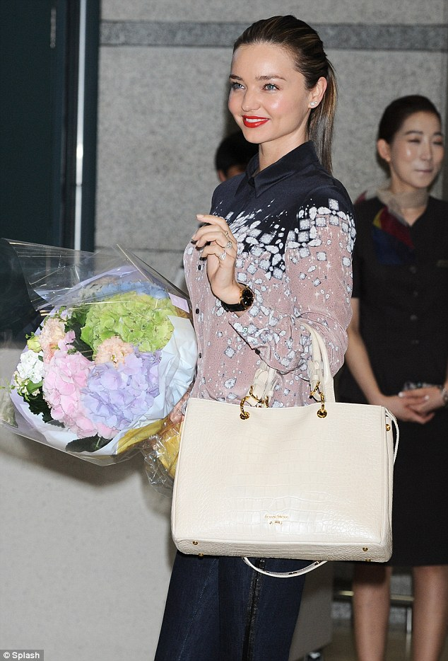 Glowing: Despite her long plane journey, Miranda looked remarkably fresh and immaculate