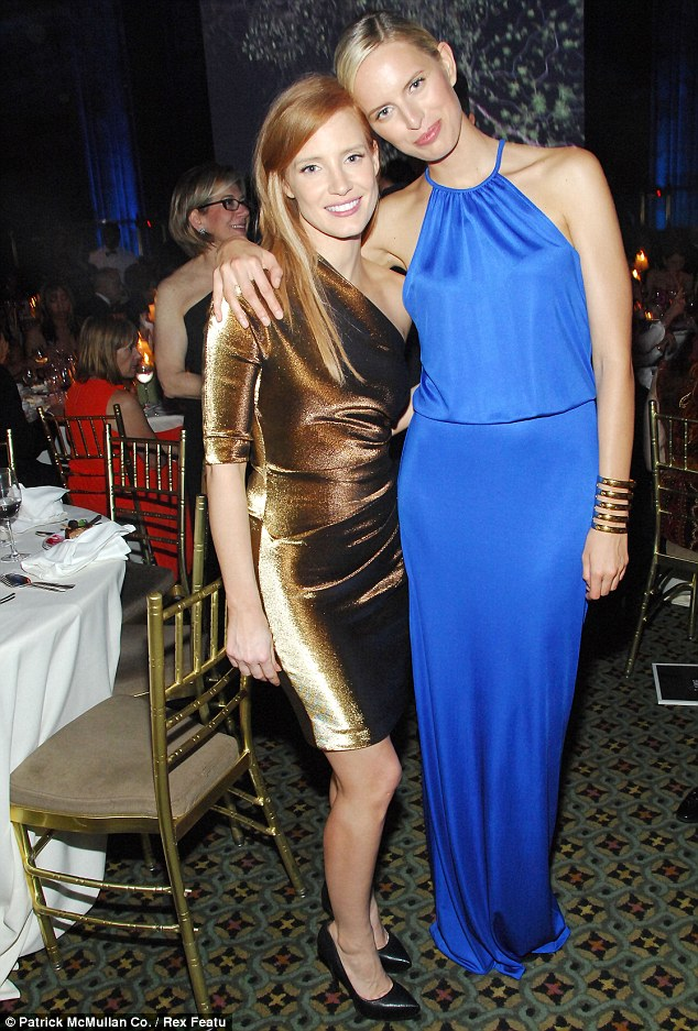 Little and large: Karolina Kurkova had to lean down to pose with Jessica Chastain at the Fashion Institute of Technology Gala in New York on Monday