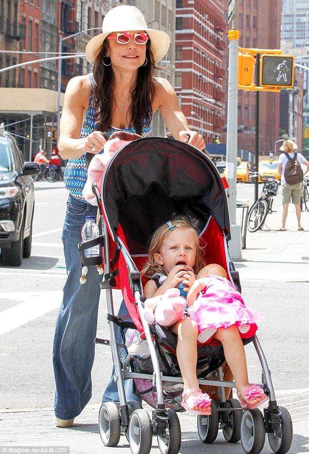 Doting mother: Bethenny was spotted out in New York again on Tuesday with her daughter Bryn in tow, and kept up the Hello Kitty theme with novelty glasses