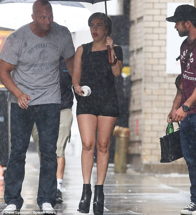 Rainy days and Mondays: Gaga toted a large golf umbrella to protect herself from the rainy weather in Manhattan