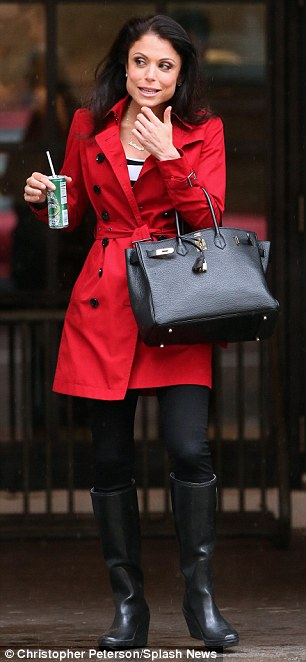 Stylish in the rain: The TV star opted for a bright coat and wedged wellies as she walked around the city after a meeting at the Industria studio