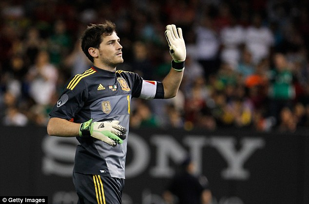 On song: Spain and Real Madrid keeper Iker Casillas pulled off the save of the evening