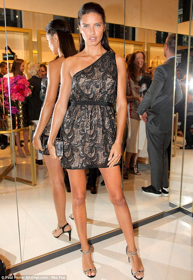 Birthday girl: Adriana Lima arrived at the VC Signature flagship store opening in New York on Tuesday