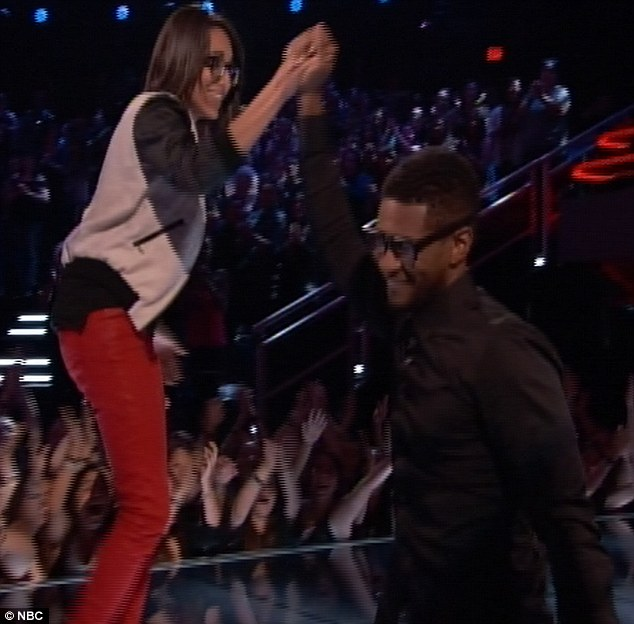 Specs appeal: Usher wore a pair of lucky glasses and they paid off as Michelle Chamuel romped through