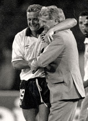 Paul Gascoigne, England footballer is pictured hugging England Manager Bobby Robson after England's victory over Cameroon in the 1990 World Cup Quarter Final