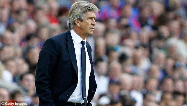 Shake-up: Pellegrini (below) will be aiming to attract a new strike force this summer after City lost Balotelli (above) in January