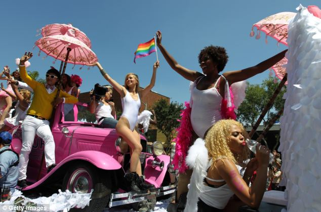 Women ride a float at the 43rd L.A. Pride Parade on June 9 in West Hollywood, California