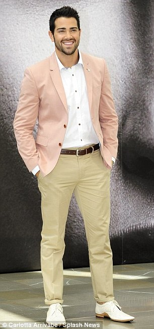 Next generation: Jesse Metcalfe looked handsomely preppy in his pink blazer and white dress shirt - both by Ted Baker - while Julie Gonzalo wore a grey-and-yellow printed mini-dress and sky-high yellow pumps