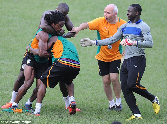 'I thought we'd finished this': Toure looks on in disbelief as Razak and Gosso grapple with eachother