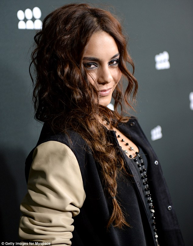 Sexy and cute: Vanessa finished off her look by wearing her wave hair ina messy side plait