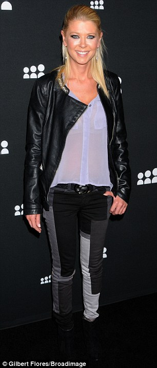 Denim divas: Tara Reid and Amy Smart both opted for jeans for the evening out, but with different takes on the look