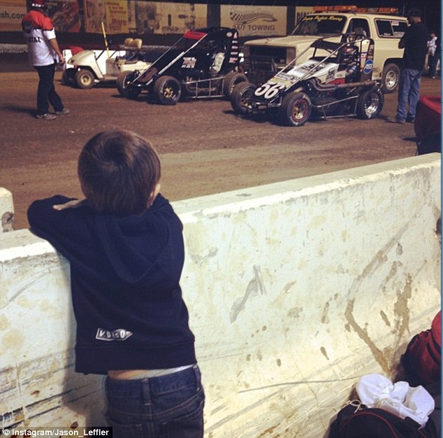 Biggest fan: The little boy regularly watched his daddy race from the sidelines