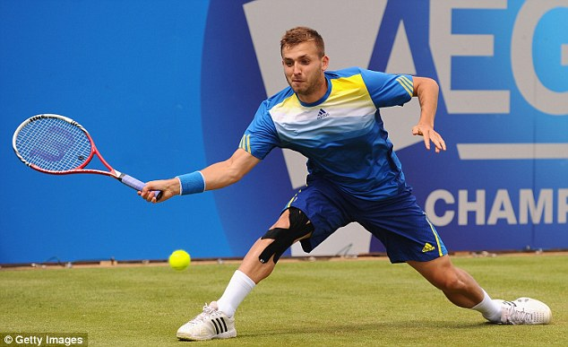 Loss: Dan Evans stretching for a shot in his defeat to Juan Martin del Potro