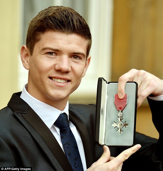 Luke here: Olympic boxer Campbell poses with his MBE