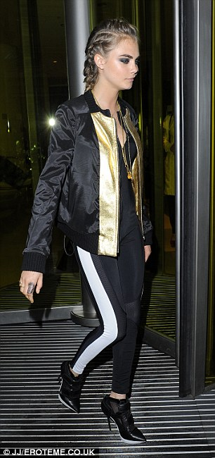 Golden girl: The model was a picture in her party outfit, with rich metal details