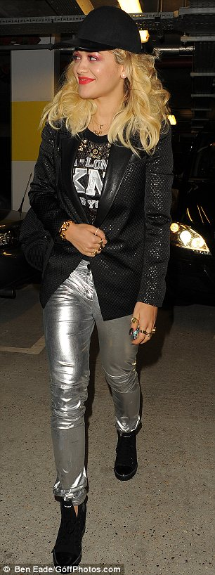 Hot metal: The singer showed off her silver trousers as she strutted to her car home